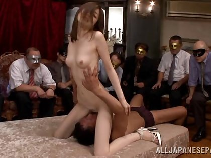 Asian couple putting on a sexy dirty show while people watch