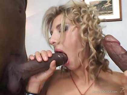 Blonde cowgirl double penetrated in a wild interracial porn
