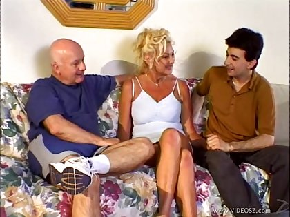 See how this cougar handles two men in an epic interracial threesome