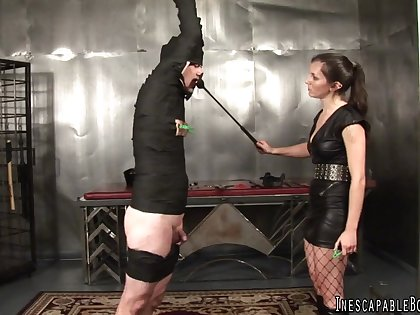 Brunette Domme ties up her man servant and spanks him with riding crop