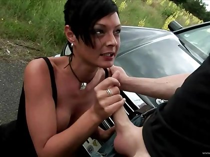 Big breasted gothic hitchhiker chick giving handjob and fucked hard in public