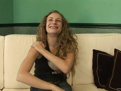Sweet teen in amateur film fingering her pussy in masturbation